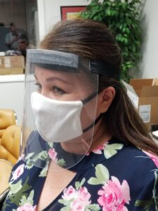 Lady in face shield and mask